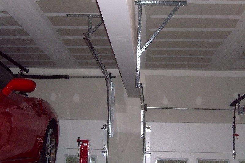 Raise garage door tracks fluidelectric for Raise garage door height